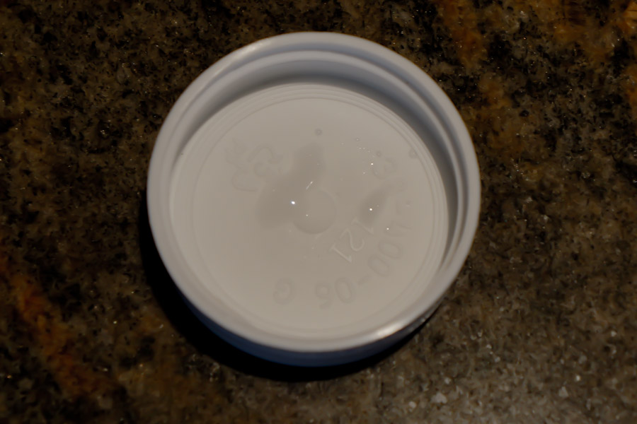 Cold bottle cap condensing water drops