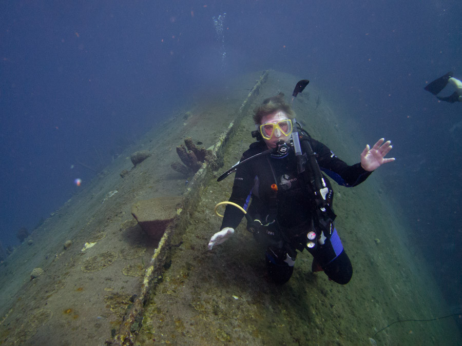 Dive buddy Michelle sitting on Helma Hooker wreck